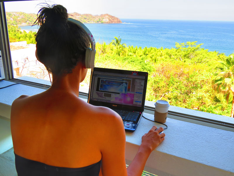 Melanie working on her membership site from our beach house in Mexico